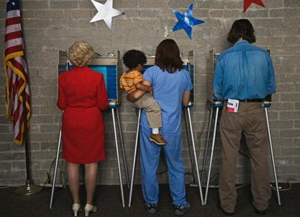 Mother with child at voting booth