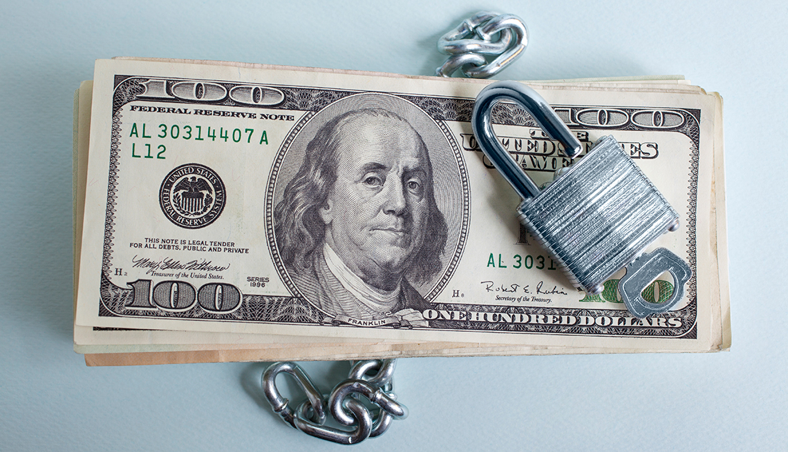 stack of 100 U.S. Dollar bills, chain and lock, AARP Research, Economic Security, Work