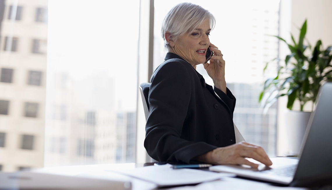 Mature female lawyer, phone call, office AARP Research, Economic Security, Work