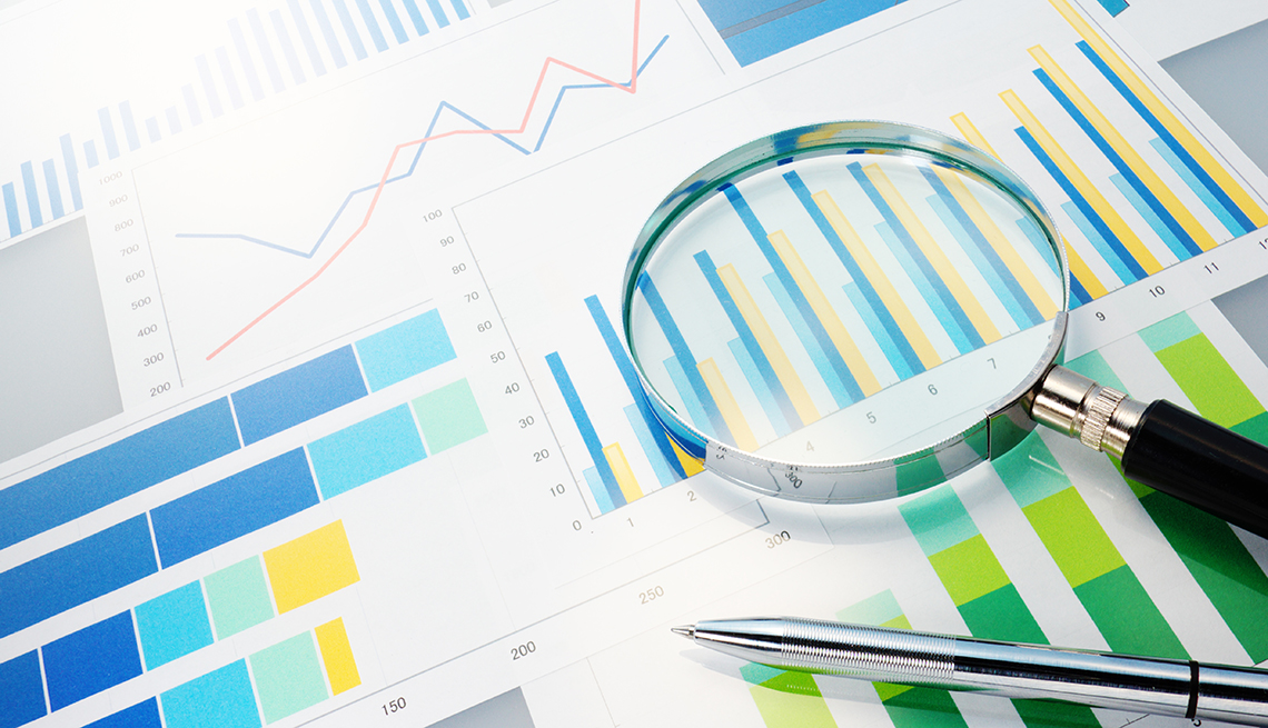 Analyzing data, charts, magnifying glass, AARP Research, General Use