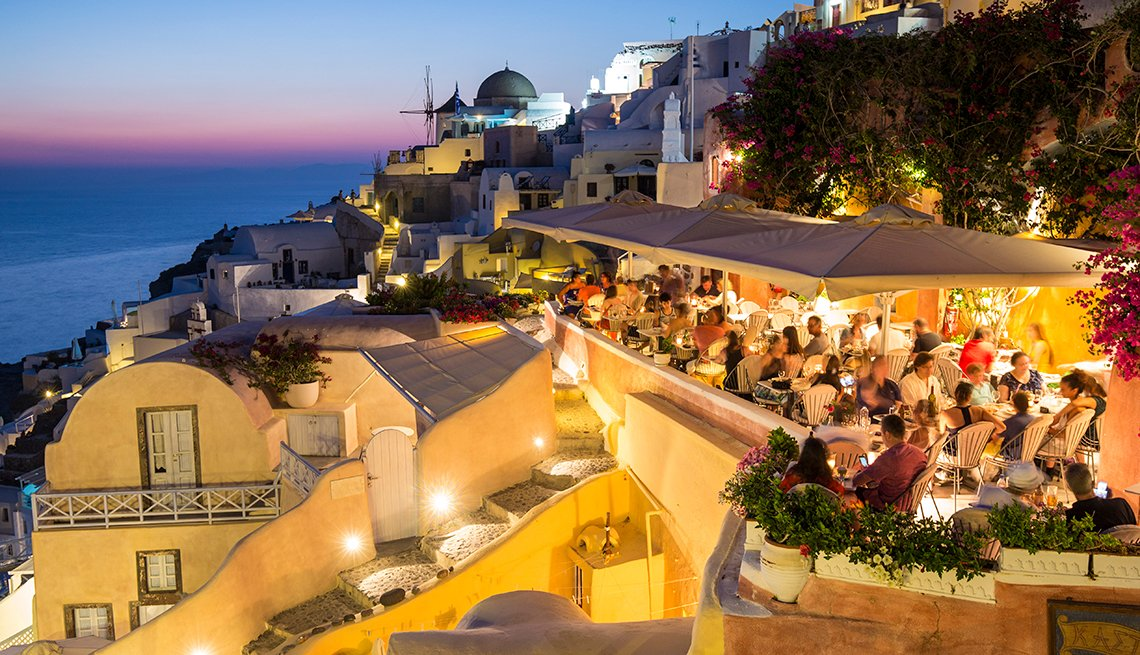 Crowded restaurant, dusk, Santorini, Cyclades Islands, Greece, AARP Research, Life, Leisure