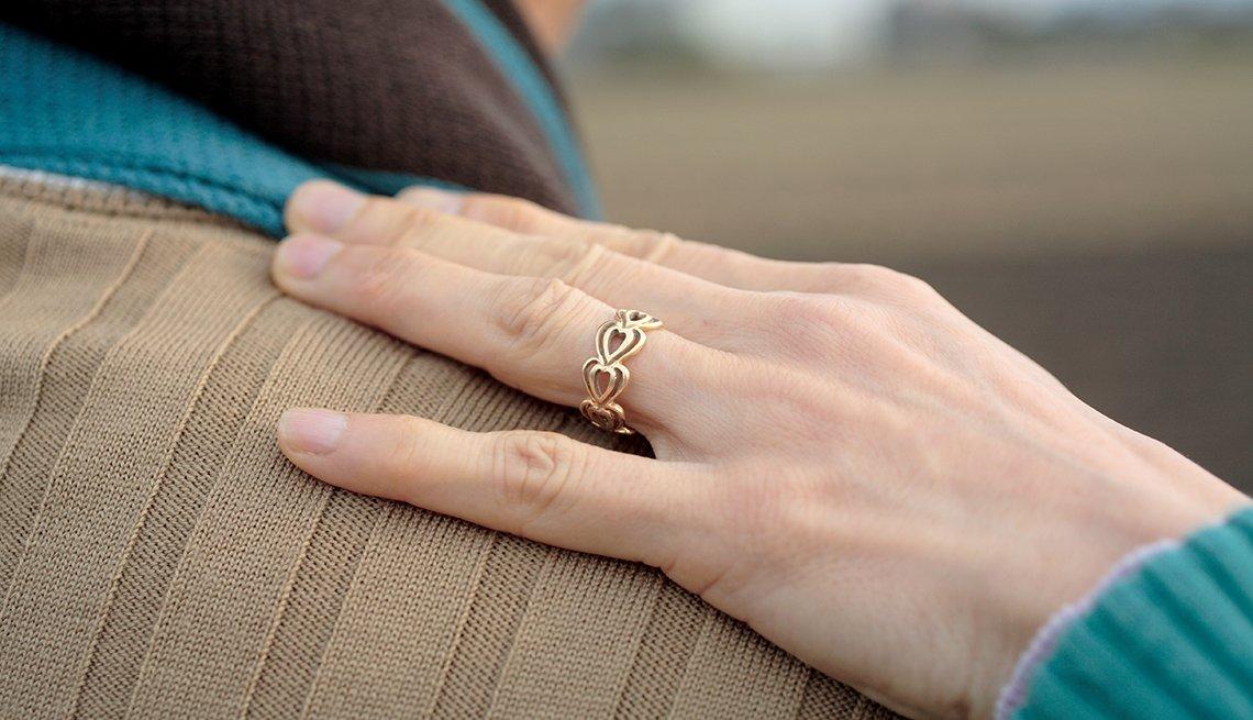Woman's hand, man's shoulder, Caregiving, AARP Research, Long-Term Care