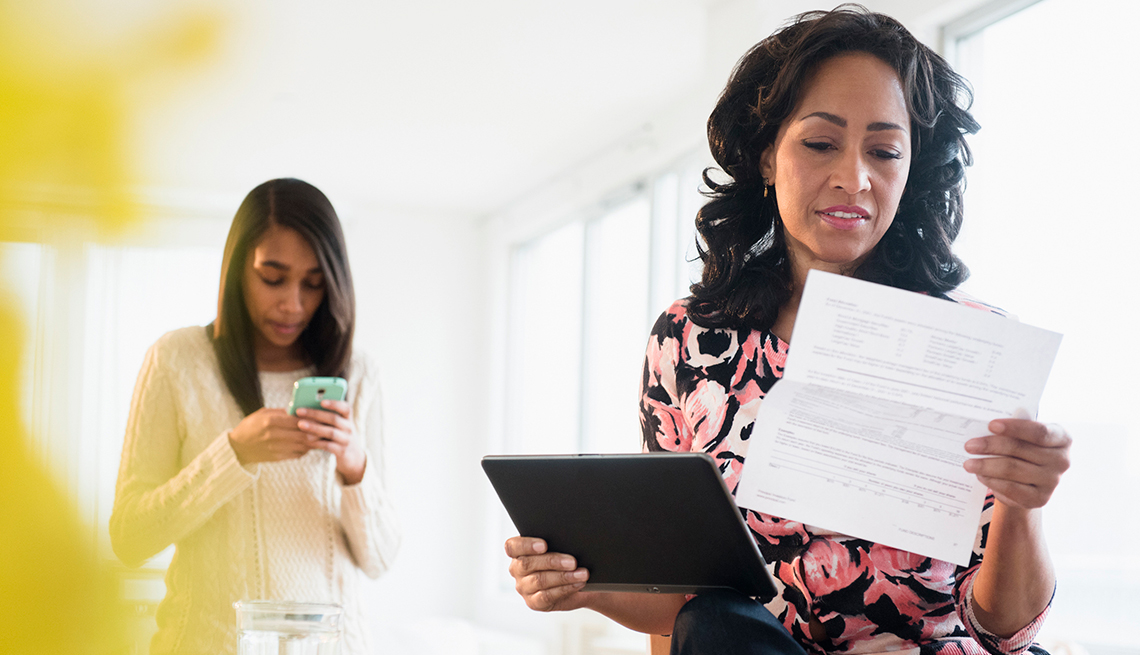 Mature woman, paying bills, Utilities, AARP Research, Technology