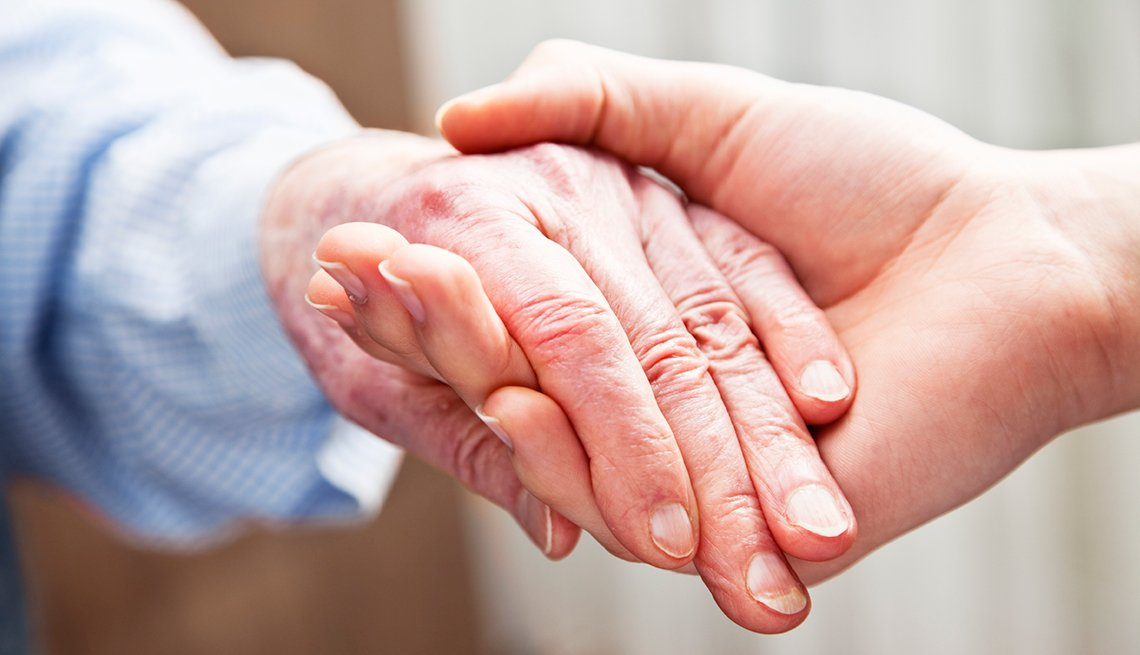 Mature woman, caretaker, holding hands, longterm care, AARP Research, Topics and Issues