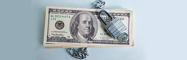 Stack of 100 Dollar bills with chain and lock