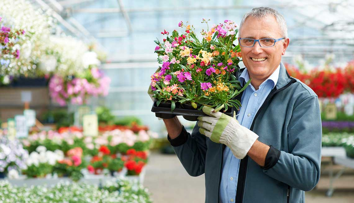 man carries Flowers - experiences with work