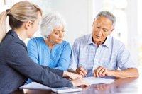 Financial Advisor Explaining Investment Plans To Senior Couple.