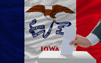 man voting on elections in front of flag US state flag of iowa