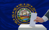man voting on elections in front of flag US state flag of new hampshire