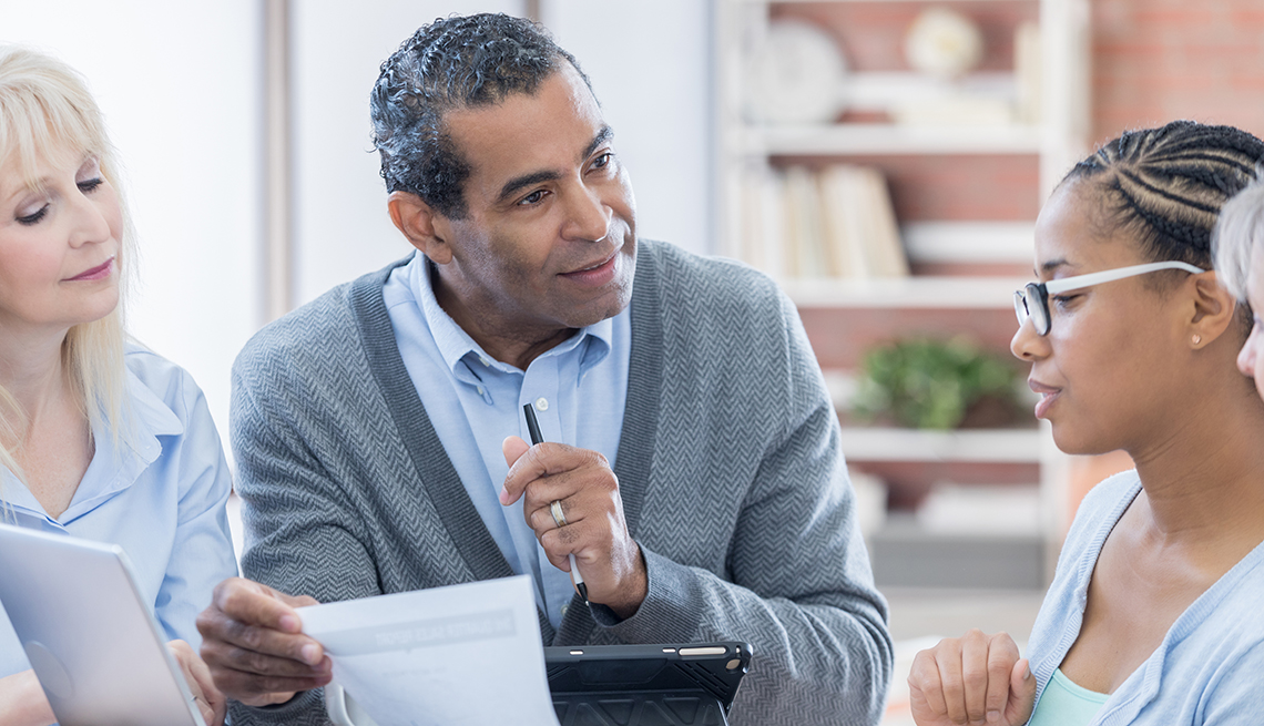 Middle Aged Man Consulting Two Women, AARP Research, Retirement Campaign Survey