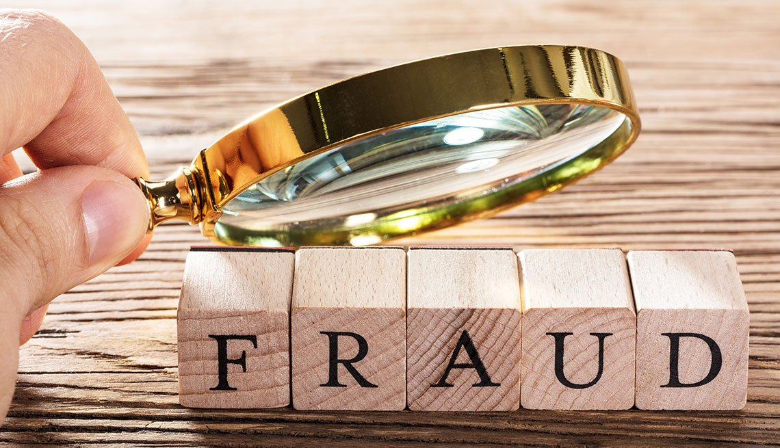 """Magnifing glass on the word """"fraud"""""""