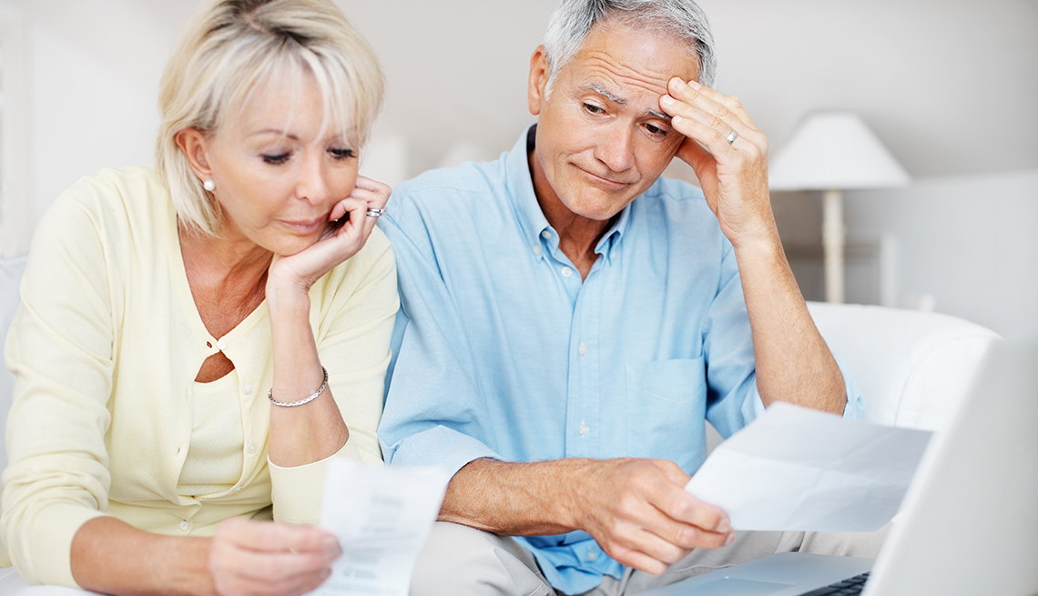 Distressed Couple Reviewing Finances