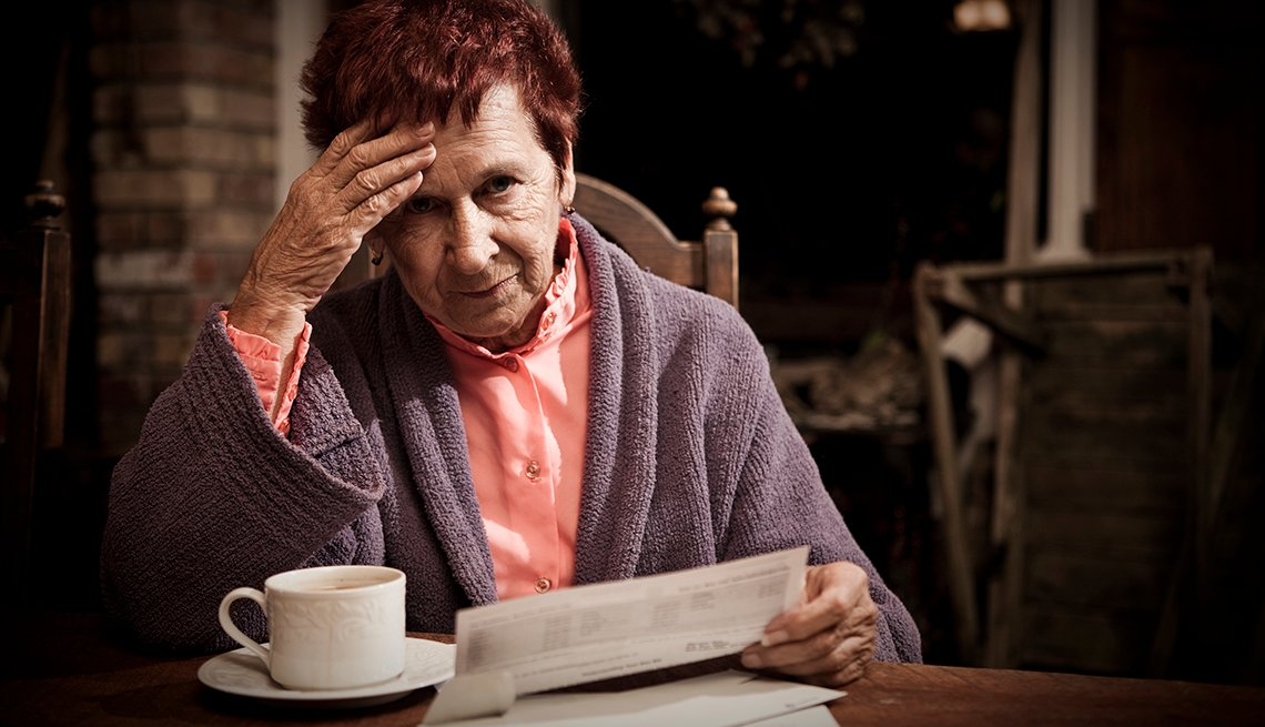 Older Woman Reviewing Bills