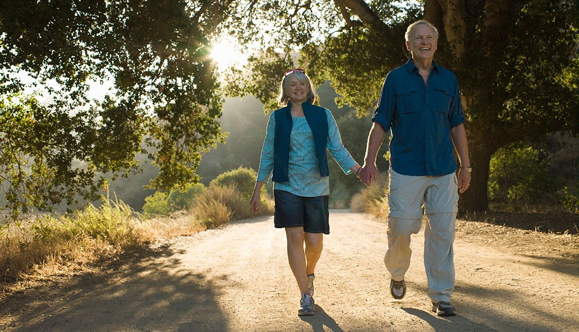 mature couple walking togther at a park