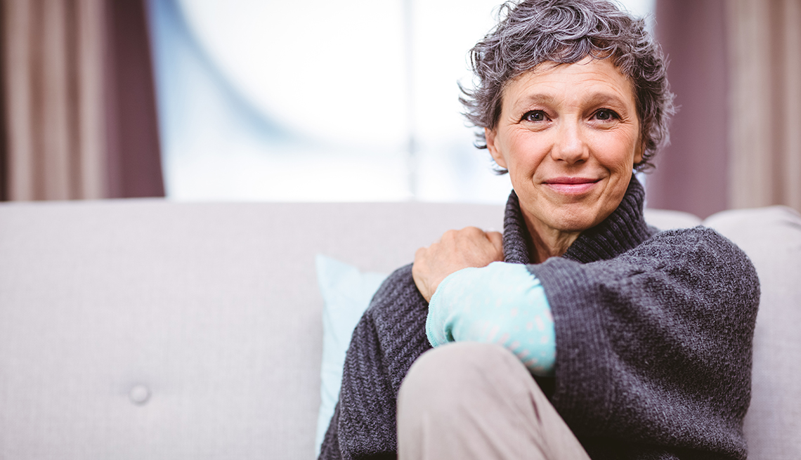 Portrait of smiling woman sitting on sofa