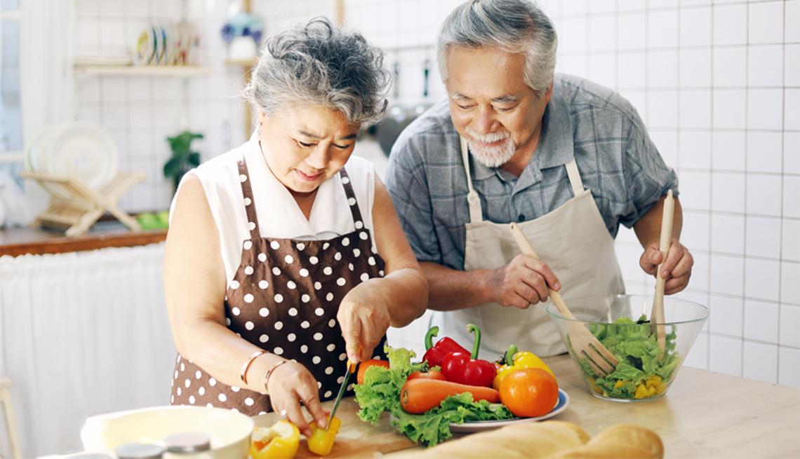 Asian Couple Preparing a Salad