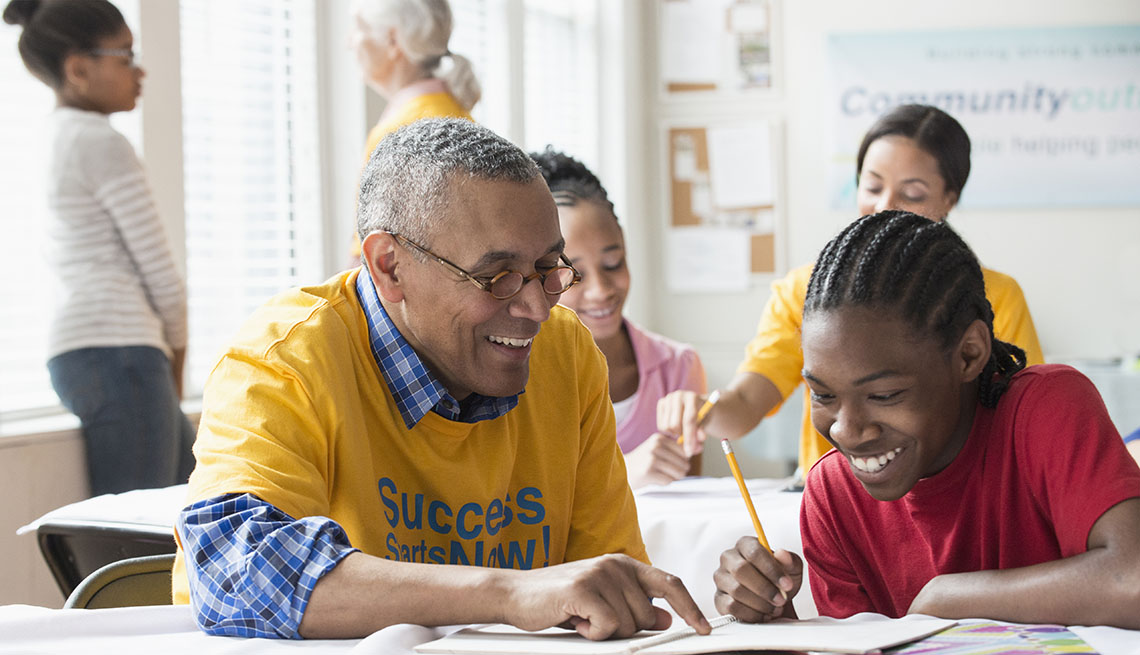 Vounteers tutoring students in classroom