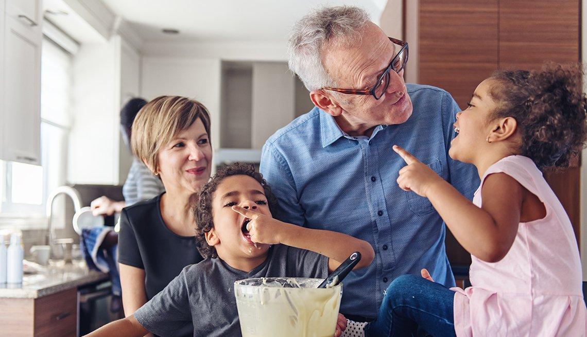 Grandparents making cupcakes with grandchildren