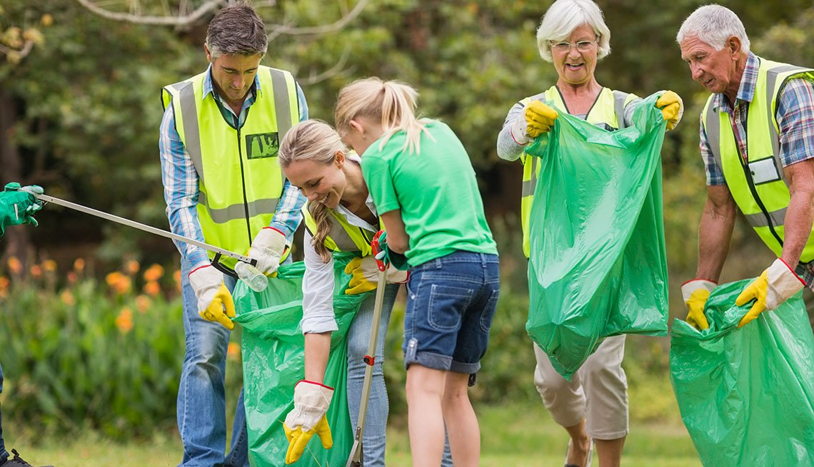 Happy family picking up rubbish