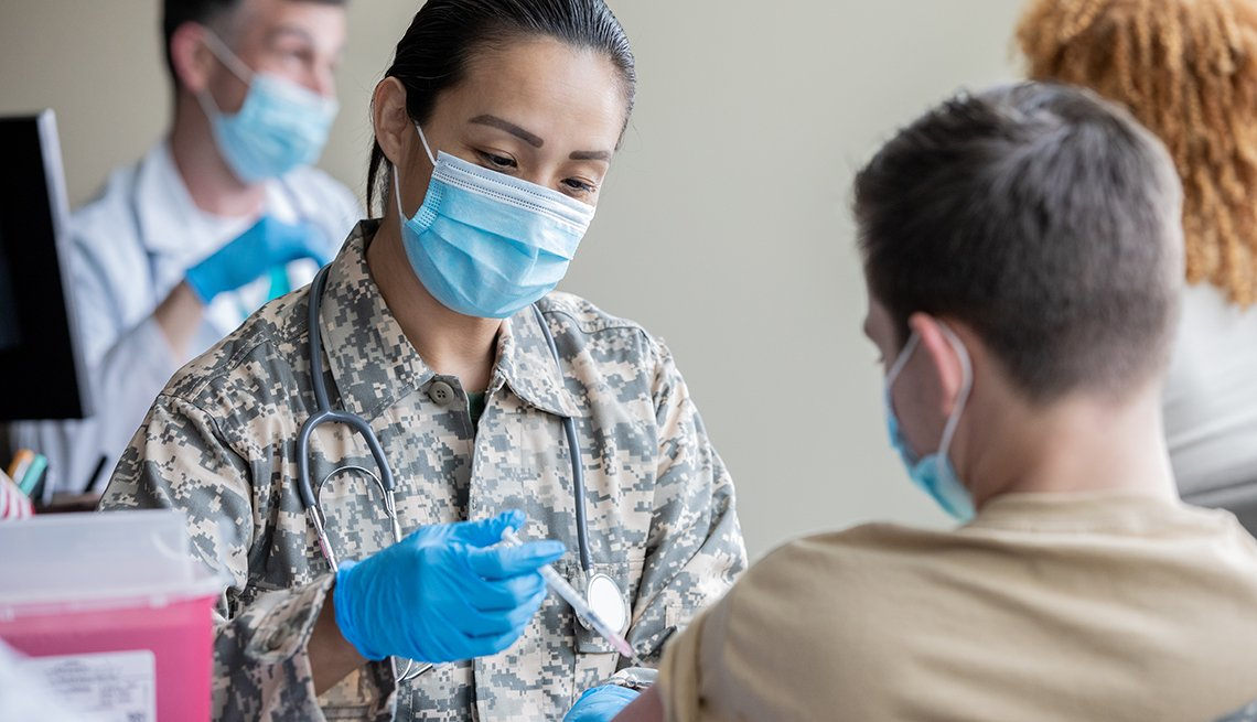 Military Doctor Gives a COVID-19 Vaccination