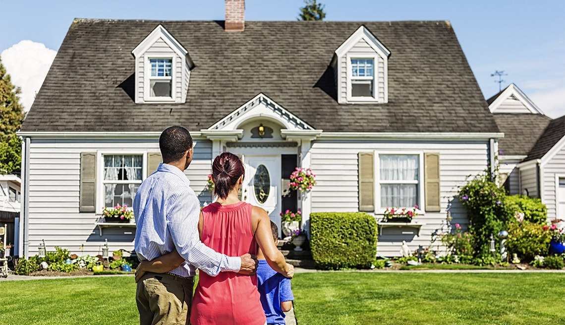 photo of a young family admiring a home