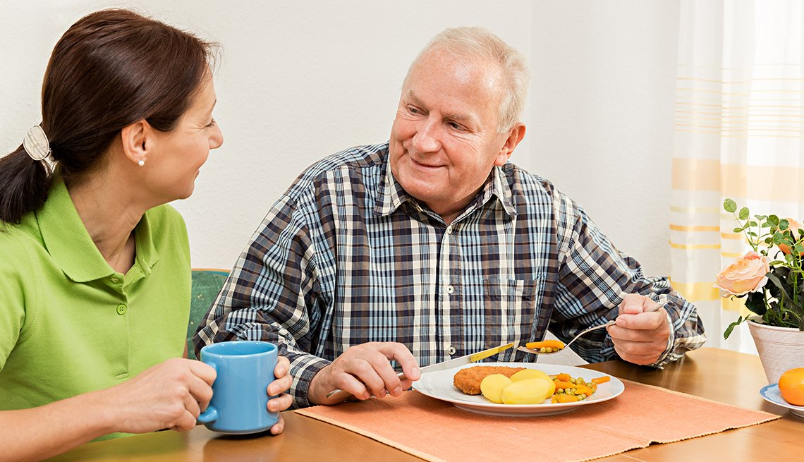 Caregiver with Mature Man Eating a Meal, AARP Family Caregiver Survey, Holiday Stressors and Emotions