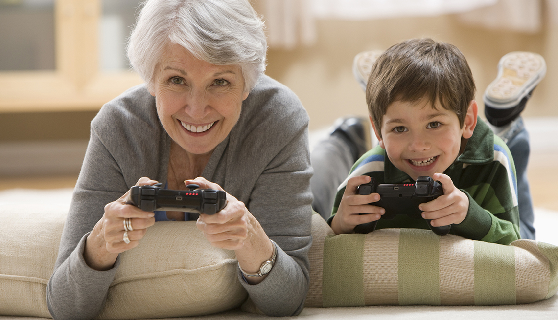 Older Woman Playing Video Games with Grandson