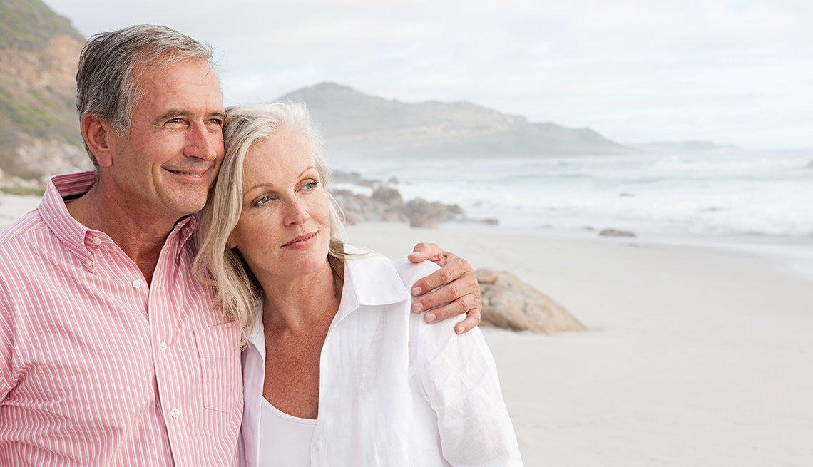 Older woman and man on beach