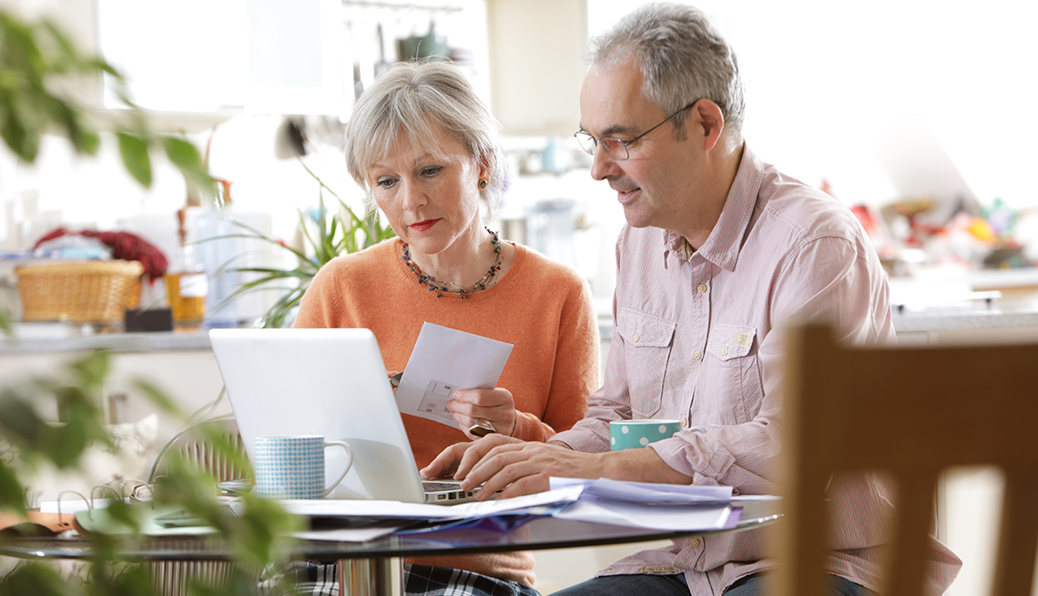 couple on computer paying bills