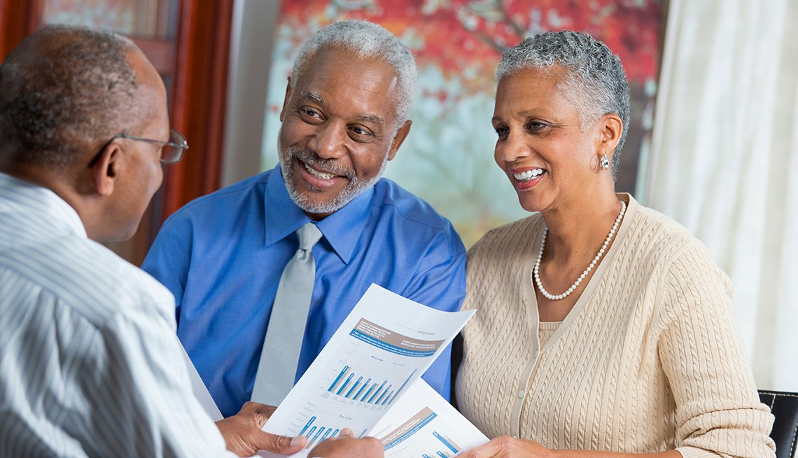 mature couple talking with a financial advisor