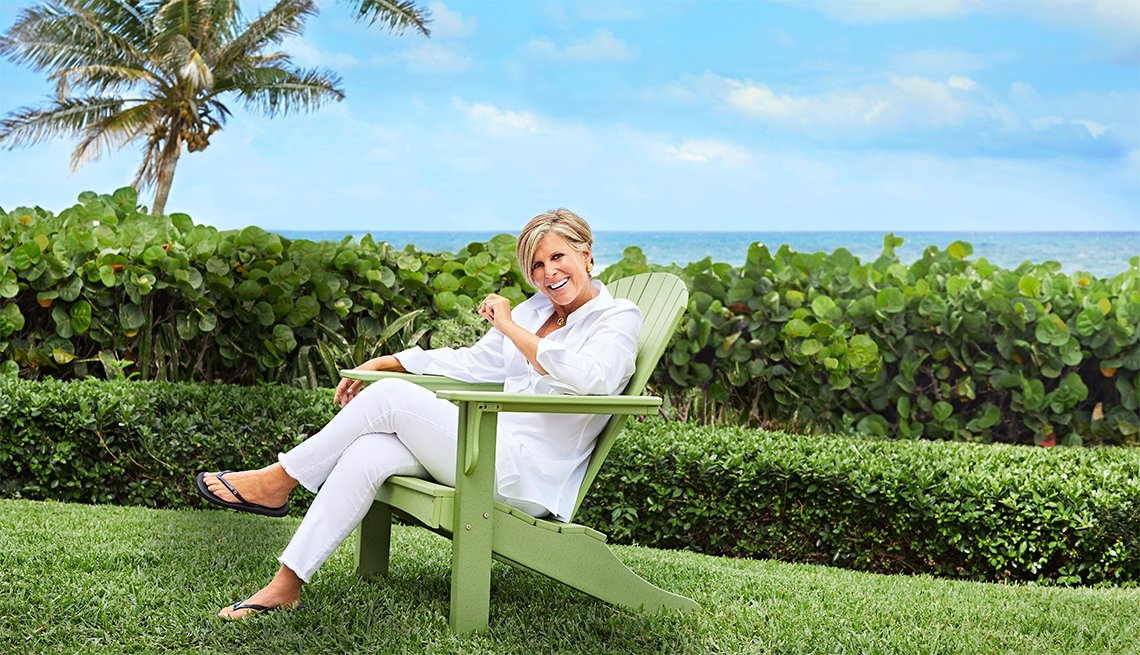 Suze Orman in a beach chair