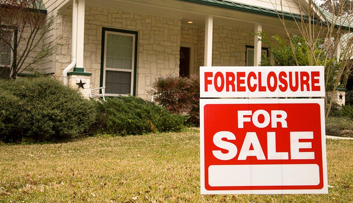 Casa con el letrero en ingés ejecución hipotecaria, se vende.