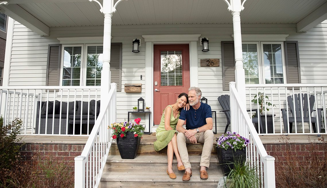 Mature couple sitting on their front porch