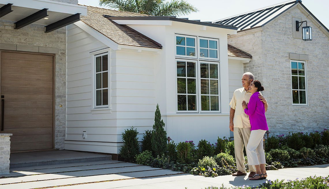 Couple looks at exterior of new home