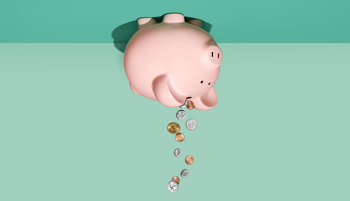 Ilustración de una alcancía de cerdito boca arriba de donde caen monedas.