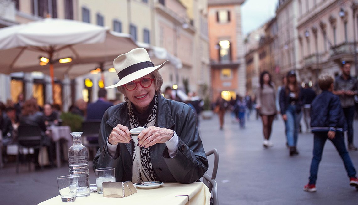 Jane Bryant Quinn sitting at an outdoor cafe in Rome, Italy