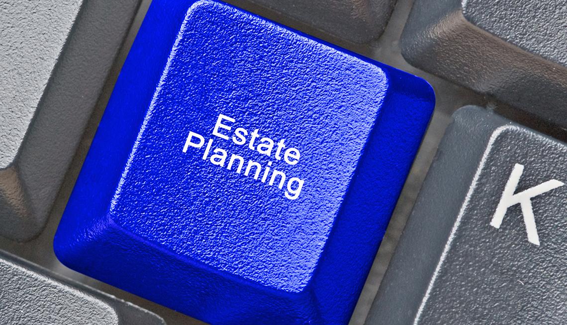 Tecla de una computadora en color azul que dice planificación patrimonial en inglés.
