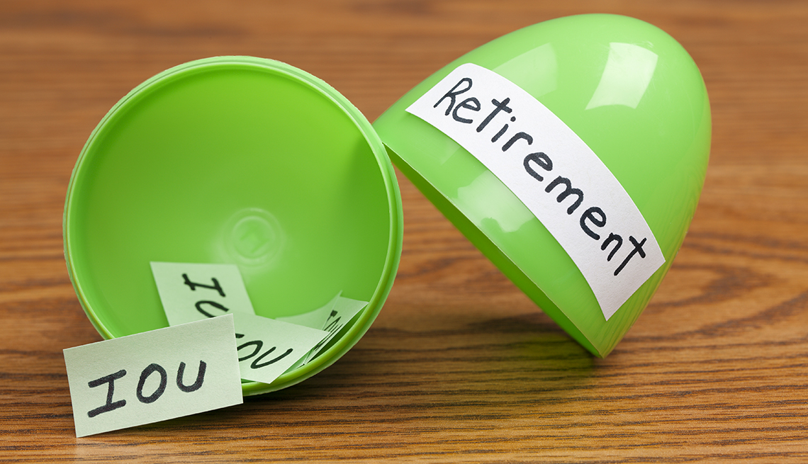 a split open green plastic egg is labeled as retirement and contains IOUs