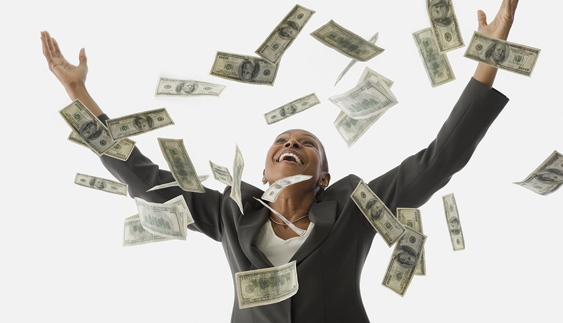 happy woman arms stretched out as money rains down