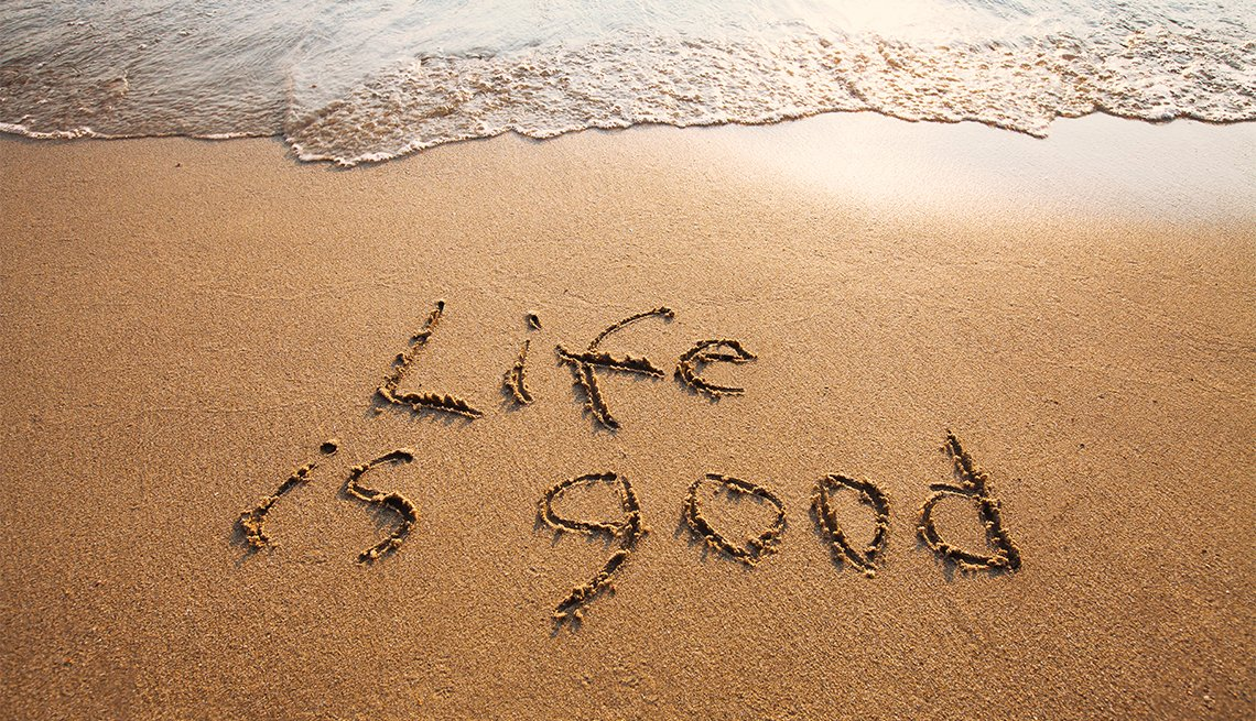 life is good written on sand on a beach
