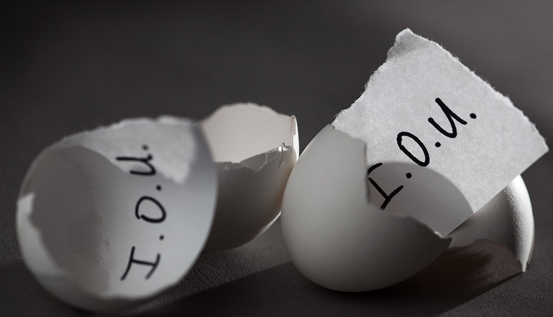 I.O.U. notes in cracked open eggs implying borrowing money from your retirement accounts