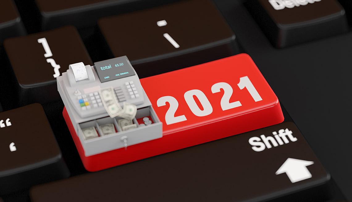 Tecla de una computadora en rojo que dice 2021 con una caja registradora encima.