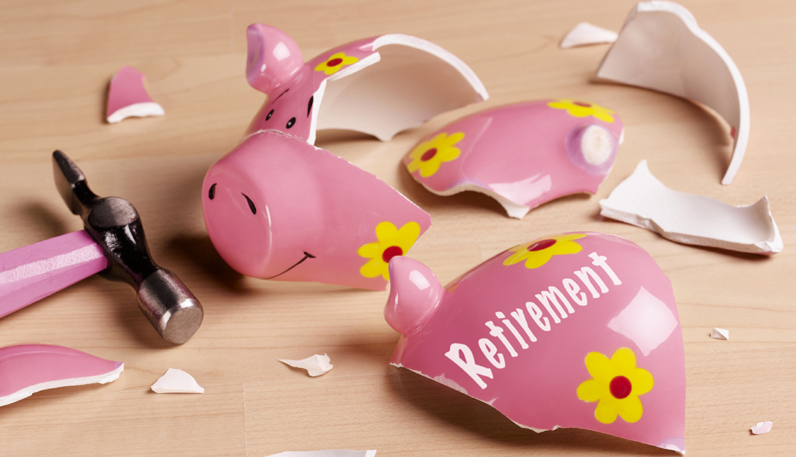 """shards of an empty piggy bank labeled """"Retirement"""" next to a hammer"""