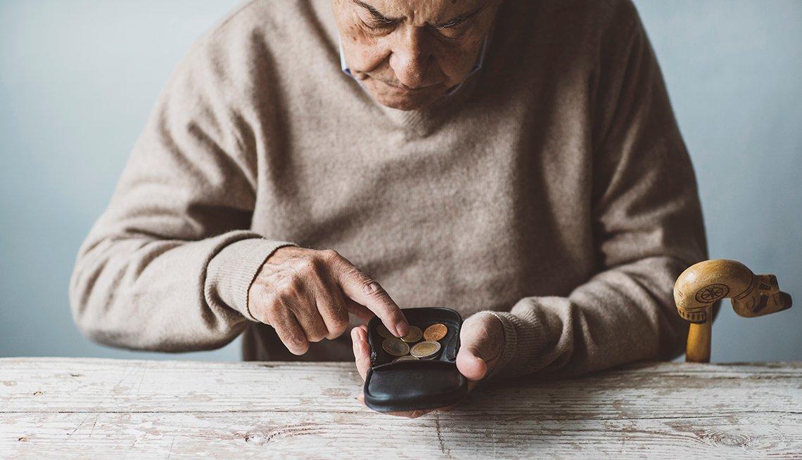 elderly man going through coin purse