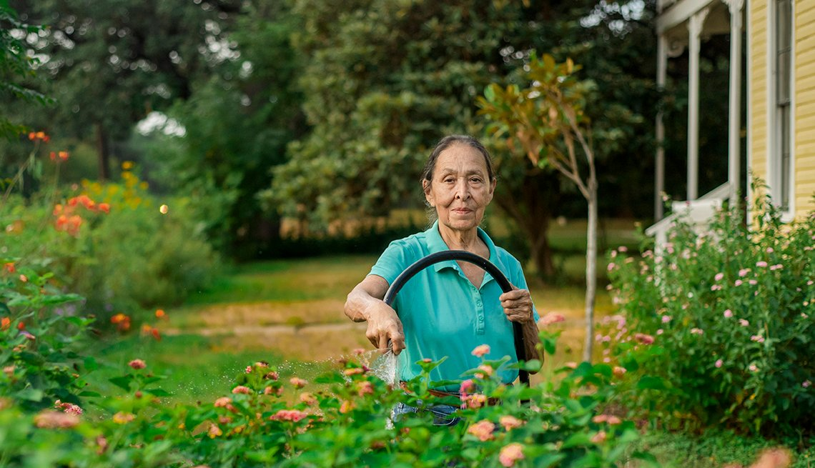 Cenorina Olivares tending to her garden