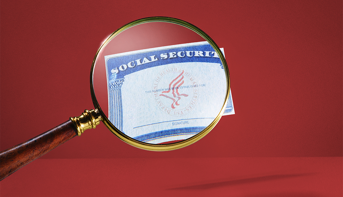 Social Security Card Magnifying Glass Red Background