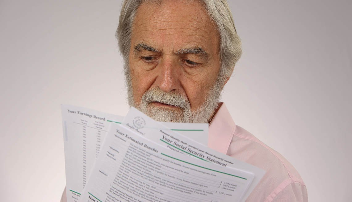 man-holds-social-security-statement