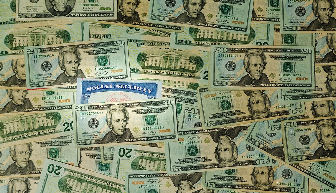 Background of 20 dollar bills  with one social security card