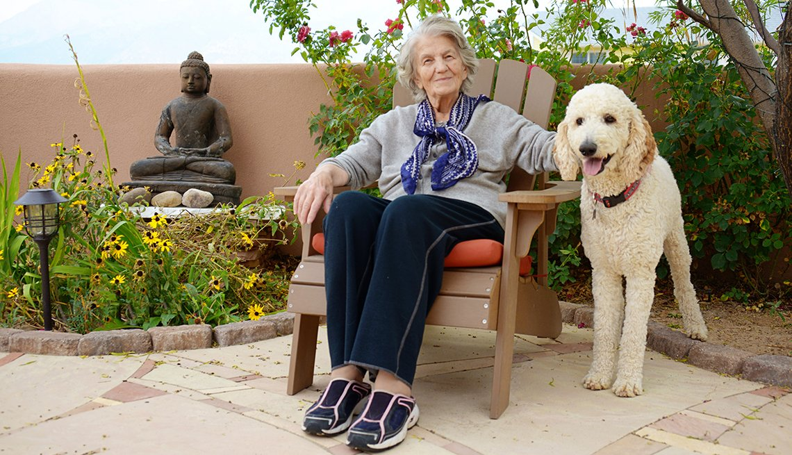 senior woman seated next to service dog