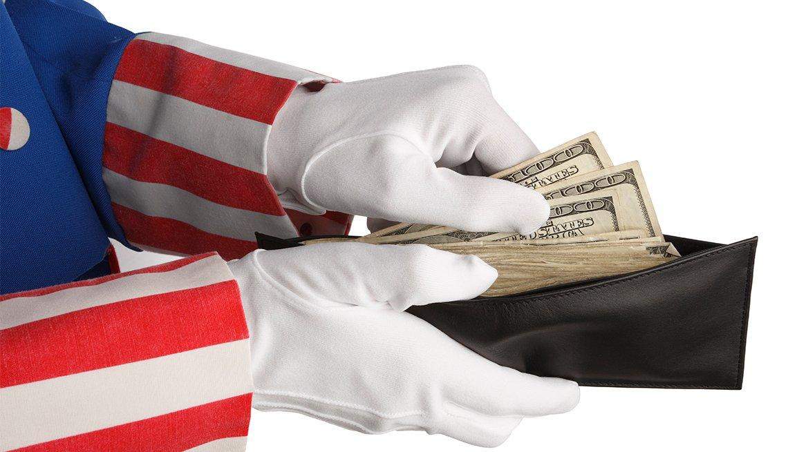 Uncle Sam gloved hands, wallet, dollars